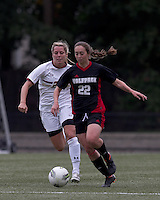 NC State defender Randi Soldat (22) brings the ball forward as Boston College forward Stephanie Wirth (22) closes. Boston College defeated North Carolina State,1-0, on Newton Campus Field, on October 23, 2011.