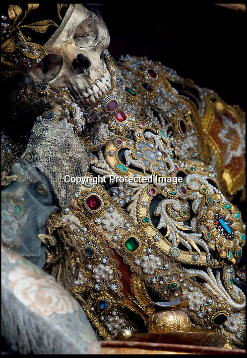 BNPS.co.uk (01202) 558833<br /> Picture: Paul Koudounaris/BNPS<br /> <br /> ***Please use full byline***<br /> <br /> Dripping with gold and jewels - lid finally lifted on the incredible remains of the Catholic saints.<br /> <br /> St Valentinus in Waldsassen.<br /> <br /> A relic hunter dubbed 'Indiana Bones' has lifted the lid on a macabre collection of 400-year-old jewel-encrusted skeletons unearthed in churches across Europe. <br /> <br /> Art historian Paul Koudounaris has hunted down and photographed dozens of gruesome skeletons in some of the world's most secretive religious establishments.<br /> <br /> Incredibly, some of the skeletons, which took up to five years to decorate, were even found hidden away in lock-ups and containers. <br /> <br /> They are now the subject of his latest book, which sheds light on the forgotten ornamented relics for the first time.