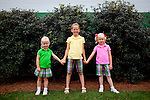 Sisters Jessica, 4, Kaleigh, 8, and Peyton Phillips, 5, pose for a portrait outside of Gate 6 of the Augusta National Golf Club on the first tournament day of The Masters Golf Tournament in Augusta, Georgia April 8, 2010. The sisters enjoy M&Ms and ice cream while their parents Jeff and Kristin, of Fairhope, Alabama, enjoy the golf.