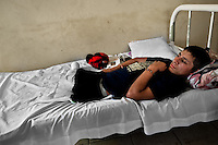 "A 16-year-old Honduran immigrant, having both his legs amputated by a train during an attempt to get illegally to the United States, lies on the bed in a refugee shelter in Tapachula, Mexico, 21 May 2011. Between 2010 and 2015, the US and Mexico have apprehended almost 1 million illegal immigrants from El Salvador, Honduras, and Guatemala. While the economic reasons remain the most frequent motivation for people from Central America to illegally immigrate to the US, thousands of Salvadorans, Guatemalans, and Hondurans, many of them minors, seek asylum in the US due to the thriving crime and gang-related violence in their region (known as the Northern Triangle). Taking an exhausting and risky journey, riding thousands of miles atop the cargo trains, facing a physical danger and extortion from the organized crime groups that control migrant routes, the ""undocumented"" still flee to the US, looking for their American dream."