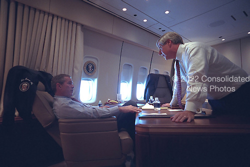 United States President George W. Bush speaks with White House Chief of Staff Andy Card aboard Air Force One, Tuesday, September 11, 2001..Mandatory Credit: Eric Draper - White House via CNP.