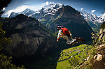 "Miles Daisher exiting from ""The High Nose"" for a wingsuit flight into the breathtaking Lauterbrunnen Valley, Switzerland."
