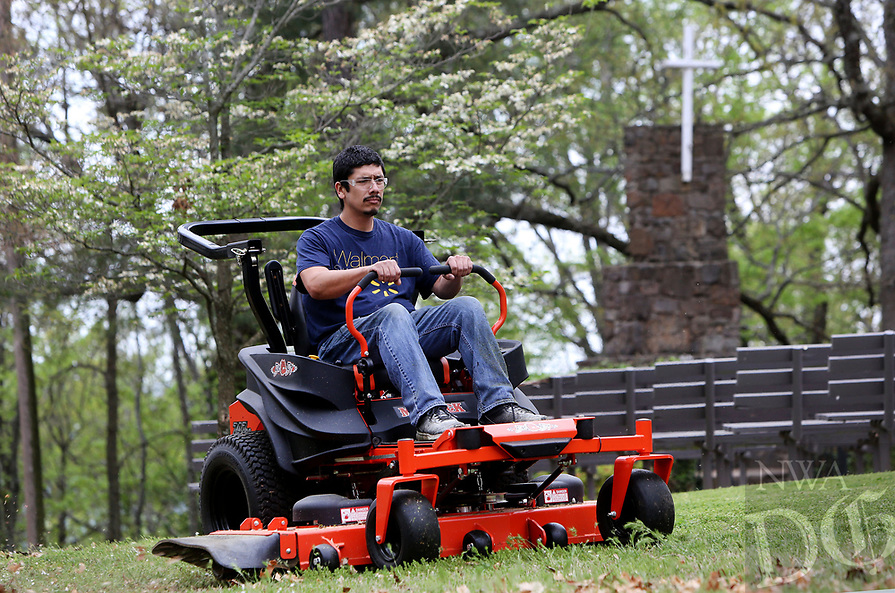 NWA Democrat-Gazette/DAVID GOTTSCHALK  Daniel Alvarez, with Year Long Lawn Care Service, mowes around the service area Friday, April 14, 2017, on Mount Sequoyah in Fayetteville. The 94th Annual Easter Sunrise at Mount Sequoyah is Sunday, April 16, beginning at 6:30 a.m. rain or shine. The service is open to everyone.