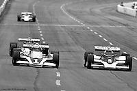 HAMPTON, GA - APRIL 22: Tom Sneva (#1 McLaren M24/Cosworth TC) and Rick Mears (#9 Penske/Cosworth TC) drive on the front straight during the Gould Twin Dixie 125 event on April 22, 1979, at Atlanta International Raceway near Hampton, Georgia.