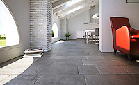 Solid Limestone Tiles with hand-cut edge, partially bush hammered surface and consumed natural undulated, time worn finish. Available in a very homogeneous Grey and a highly variegated Beige.