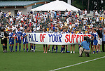 9 August 2003: Courage players unroll a banner thanking the fans after the game. The Carolina Courage tied the Philadelphia Charge 1-1 at SAS Stadium in Cary, NC in the final regular season WUSA game.