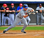 8 March 2009: New York Mets' infielder Andy Green lays down a bunt single in the first inning of a Spring Training game against the Washington Nationals at Space Coast Stadium in Viera, Florida. The Nationals defeated the Mets 8-3 in the Grapefruit League matchup. Mandatory Photo Credit: Ed Wolfstein Photo