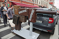 Moscow, Russia, 19/05/2012..An artwork consisting of suitcases fashioned to look like a gun and bearing the work ?kompromat?, Russian jargon for compromising material, as several thousand artists and opposition activists demonstrate against Vladimir Putin by walking through Moscow transporting their artworks. The protest coincided with Museum Night, when Moscow's museums are open until midnight with special exhibitions and performances.