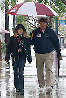 Santa Monica Ambassador J.D. Simpson shares his umbrella while escorting Courtney Greene along the Third Street Promenade on Wednesday, January 20, 2010. Downtown Santa Monica's Ambassador Program was created to provide an inviting and safe atmosphere in the district. Ambassadors are trained in a variety of tasks, including: providing information to visitors, giving directions, offering escort services to employees, reporting maintenance issues and any other action that serves to make the district more inviting.