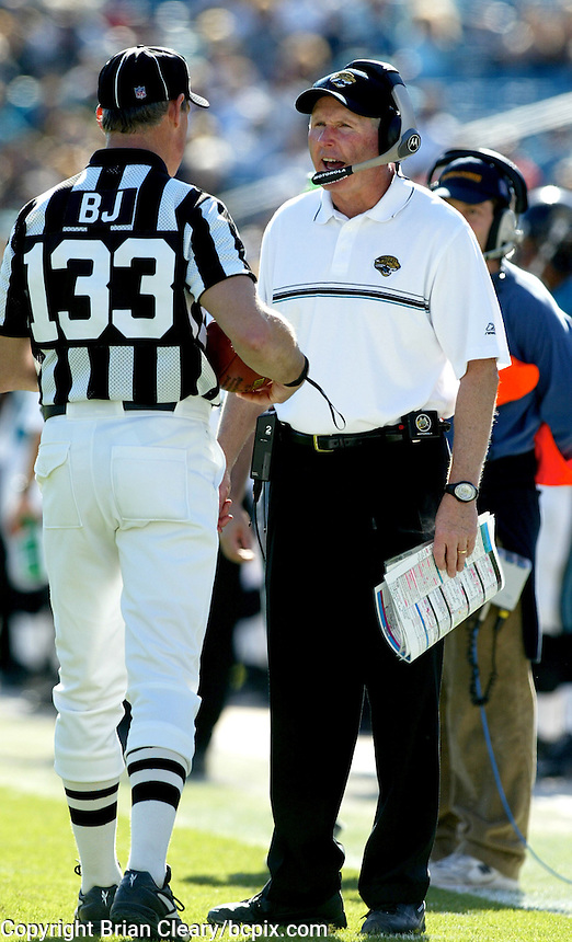 Jacksonville Jaguar head coach Tom Coughlin (right) discusses a play with an official during a game against the Jacksonville Jaguars in Jacksonville, FL on Sunday, December 22, 2002.  Tennessee won the game 28 to 10. (Photo by Brian Cleary/www.bcpix.com)