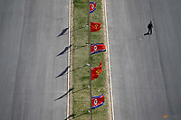 A man walks the the street decorated with flags as North Korea prepares to mark Saturday's 105th anniversary of the birth of Kim Il-sung, North Korea's founding father and grandfather of the current ruler, in central Pyongyang, North Korea April 12, 2017.    REUTERS/Damir Sagolj