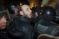 Moscow, Russia, 31/01/2011..Police seize a demonstrator at a monthly Strategy 31 anti-government demonstration. Opposition activists hold regular demonstrations on the 31st day of the month, protesting against restrictions on the freedom of assembly, which is protected by article number 31 of the Russian constitution.