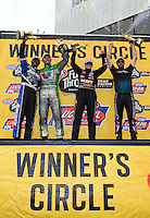 Sept. 30, 2012; Madison, IL, USA: NHRA (L-R) top fuel dragster champion Antron Brown, funny car champion Jack Beckman, pro stock champion Erica Enders and pro stock motorcycle champion Eddie Krawiec celebrate after winning the Midwest Nationals at Gateway Motorsports Park. Mandatory Credit: Mark J. Rebilas-
