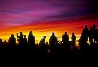 People enjoy the predawn light show preceding sunrise at 9,740 feet on Mt. Haleakala in Haleakala National Park, Maui.