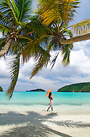 Young woman enjoying the beach<br /> Big Maho Bay<br /> Virgin Islands National Park<br /> St. John, U.S. Virgin Islands