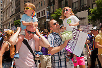 Fathers with their children march thanking Gov. Andrew Cuomo for passing the the gay marriage legislation in the 43rd annual Lesbian, Gay, Bisexual and Transgender Pride Parade on Fifth Avenue in New York on Sunday, June 24, 2012. The parade took place on the one year anniversary of the legalization of gay marriage in New York.  (© Richard B. Levine)