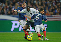 Jeremy Mathieu of team France, Jozy Altidore of team USA and Laurent Koscielny of team France (l-r) fight for the ball during the friendly match France against USA at the Stade de France in Paris, France on November 11th, 2011.