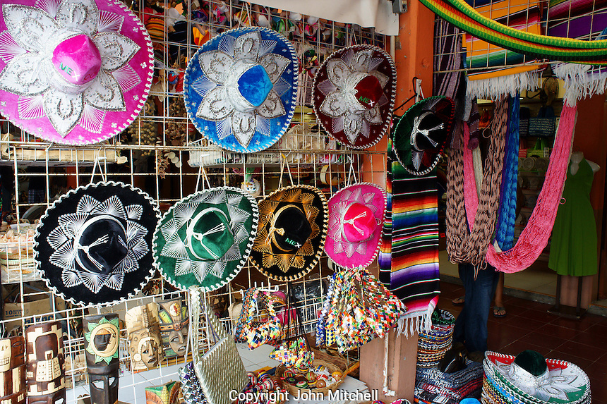 Mexican sombreros, hammocks, and other handicrafts in Mercado 28 souvenirs and handicrafts market in  Cancun, Mexico      .