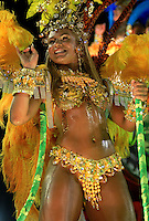 A dancer from Estacio de Sa samba school performs at the Sambadrome during the samba school parade in Rio de Janeiro, Brazil, February 21, 2009.