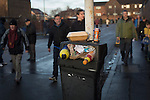 Motherwell 3 Dundee 1, 12/12/2015. Fir Park, Scottish Premiership. Spectators walking past a litter bin at Fir Park, home to Motherwell Football Club, before they played Dundee in a Scottish Premiership fixture. Formed in 1886, the  home side has played at Fir Park since 1895. Motherwell won the match by three goals to one, watched by a crowd of 3512 spectators. Photo by Colin McPherson.