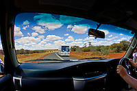 View of coach from interior of four-wheel-drive vehicle, Red Centre, Australia