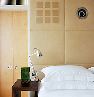 The bedroom walls are panelled with imitation suede, the fabric chosen to ensure that the sound from the loudspeakers behind the panels would not be distorted
