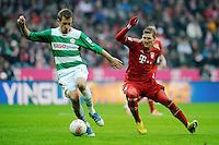 FUSSBALL   1. BUNDESLIGA  SAISON 2012/2013   18. Spieltag FC Bayern Muenchen - SpVgg Greuther Fuerth       01.12.2012 Bastian Schweinsteiger (re, FC Bayern Muenchen) gegen Milorad Pekovic (Greuther Fuerth)