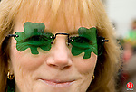 WATERBURY, CT--10 MARCH 2007--031007JS28- Ellen Bergin, a member of the Ladies Ancient Order of Hibernians dons her shamrock glasses for the annual Waterbury St. Patrick's Day Parade on Saturday. The parade is organized by the Ancient Order of Hibernians. <br /> Jim Shannon / Republican-American