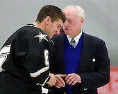 Longtime Army coach and father of Army's current coach Jack Riley speaks to Cody Omilusik (Army - 6) prior to dropping the puck. - The host Colgate University Raiders defeated the Army Black Knights 3-1 in the first Cape Cod Classic at the Hyannis Youth and Community Center in Hyannis, MA.