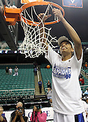 Jasmine Thomas cuts down the net at the conclusion of the game.This was the Championship game of the 2011 ACC Tournament in Greebsboro on March 6, 2011. Duke beat UNC 81-66. (Photo by Al Drago)