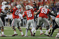 Ohio State Buckeyes quarterback J.T. Barrett (16) looks for a pass in the fourth quarter of their game at Ohio Stadium in Columbus, Ohio on October 29, 2016. (Columbus Dispatch photo by Brooke LaValley)
