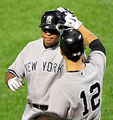 New York Yankees left fielder Andruw Jones (18) is congratulated by Eric Chavez (12) after hitting his home run in the sixth inning against the Baltimore Orioles at Oriole Park at Camden Yards in Baltimore, Maryland in the second game of a doubleheader on Sunday, August 28, 2011.  The Yankees won the game 8 - 3, earning a split in the two games..Credit: Ron Sachs / CNP.(RESTRICTION: NO New York or New Jersey Newspapers or newspapers within a 75 mile radius of New York City)