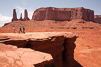 Touists enjoy the views at John Ford's Point at Monument Valley Navajo Tribal Park in southern Utah. The park, operated by teh tribe, was once a popular set for western films of the 1930s through 60s. It is immensely popular among European tourists. (Kevin Moloney for the New York Times)