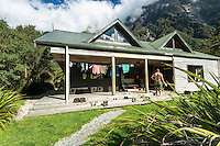 Welcome Flat Hut and relaxing hikers, Westland National Park, West Coast, World Heritage Area, South Westland, New Zealand