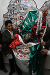 """Mexican Boxer Edgar """"Tun Tun"""" Cardenas unfolds a flag during a ceremony where he was accepted as a new member of the Hall of Fame in Toluca City, September 13, 2007. Photo by Javier Rodriguez"""