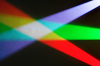 Overlapped projection of the primary light colors red, green, and blue on a white surface produces white.
