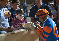 Javier Castellano signs autographs for fans after winning the Charles Town Classic on Charles Town Classic Night at Charles Town Races & Slots in Ranson, West Virginia on April 14, 2012.
