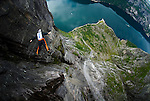 Freefalling next to the waterfall from exit #5 on Kjerag.  Lysefjorden, Norway.