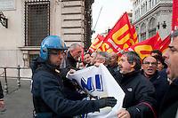 Roma, 15 Dicembre  2011.Manifestazione dell'USB contro il governo Monti davanti  Palazzo Chigi, la polizia li ferma..
