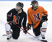 Members of the Northeastern women's team watch the shootout drill. - The visiting Niagara University Purple Eagles defeated the Northeastern University Huskies 4-1 on Friday, November 5, 2010, at Matthews Arena in Boston, Massachusetts.
