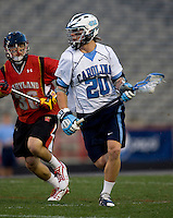 Jimmy Dunster (20) of North Carolina brings the ball into the attacking area while being defended by Jesse Bernhardt (36) of Maryland during the ACC men's lacrosse tournament semifinals in College Park, MD.  Maryland defeated North Carolina, 13-5.