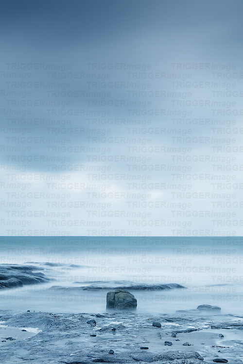 Storm over the sea with rocks