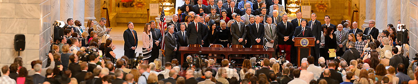 Trent Nelson  |  The Salt Lake Tribune<br /> Gov. Gary Herbert signs into law SB296, which gives statewide non-discrimination protections to the gay and transgender community, while providing safeguards for religious liberty, in the rotunda of the State Capitol Building in Salt Lake City, Thursday March 12, 2015.