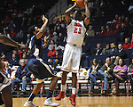 "Ole Miss' Reginald Buckner (23) is fouled by East Tennessee State's John Walton (21) at the C.M. ""Tad"" Smith Coliseum in Oxford, Miss. on Saturday, December 14, 2012. Mississippi won 77-55 to improve to 7-1. (AP Photo/Oxford Eagle, Bruce Newman).."