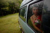 """A girls wearing traditional clothes sits in a van as she protects herself from the rain during a religious ceremony outside a temple in the village of Suan Mon near Udon Thani in northeastern Thailand June 25, 2011. Regional leaders of Thailand's red-shirt protest movement held traditional Buddhist ceremony to launch 38 villages designated as """"Red Shirt Village of Democracy."""" The red shirts, supporters of ousted premier Thaksin Shinawatra, have been branding hundreds of villages as red to rally behind Thaksin's sister, Yingluck, who is leading the opposition ahead of July 3 general elections.   REUTERS/Damir Sagolj (THAILAND)"""
