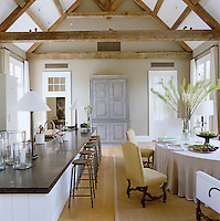 In the kitchen/dining area a large painted cupboard is situated on the opposite wall to the contemporary fireplace creating a pleasing symmetry