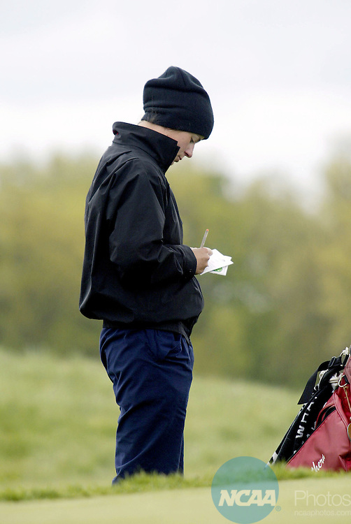 18 May 2002:  Sophomore Jana Peterkova of Florida Southern College checks her score card during the final round of the Division 2 Women's Golf Championship held at the Meadows Golf Club on the Grand Valley State campus in Allendale, MI.  Peterkova won the individual champioship and Florida Southern took the team title.  Mike Farrell/NCAA Photos