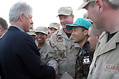 Former United States President Bill Clinton greets airmen at a deployed location January 12, 2004.  The former president spent more than one hour shaking hands, signing mementos and posing for photographs during his visit.  <br /> Mandatory Credit: Lynne Neveu / USAF via CNP