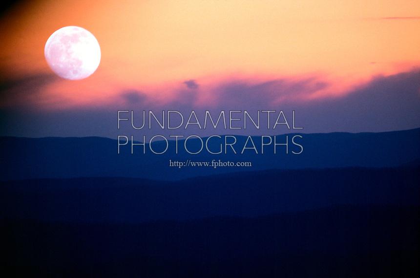 MOONRISE<br /> Over mountains at dusk.