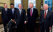 Washington, D.C. - January 7, 2009 -- United States President George W. Bush, center welcomes former United States President George H.W. Bush, left; United States President-elect Barack Obama, left center; former United States President Bill Clinton, right center; and former United States President Jimmy Carter, right; to the Oval Office of the White House in Washington, DC on Wednesday, January 7, 2009.  This was the first time all of the living past, present and future Presidents were at the White House together since 1981..Credit: Ron Sachs / Pool via CNP
